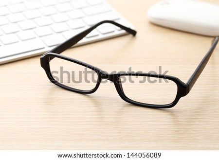 Keyboard, mouse and glasses - stock photo