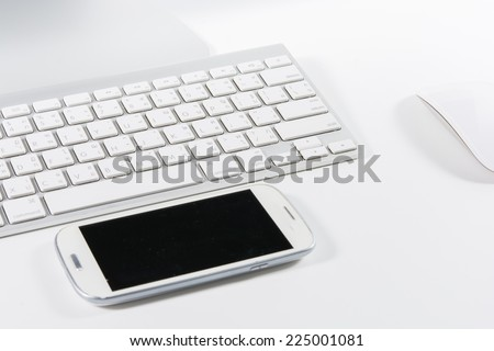 Keyboard mouse and smartphone isolated on white background - stock photo