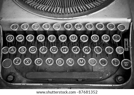 Keyboard of a vintage typewriter in black and white - stock photo