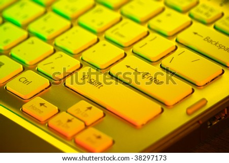 Keyboard of an open notebook. Closeup - stock photo