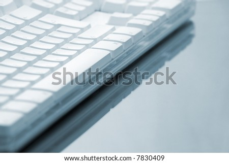 Keyboard on Reflective Surface - stock photo