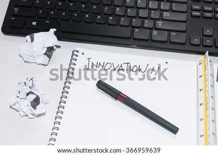 keyboard, pen and scale ruler with INNOVATION word. Selective focus,shallow depth of field.