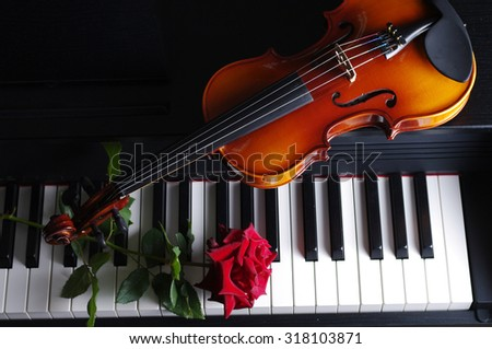 Keyboard, red roses and violin