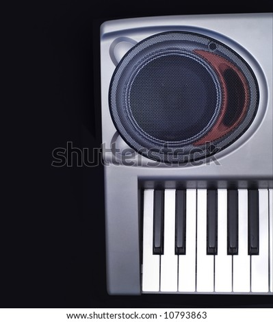 Keyboard synthesizer, detail, on black background - stock photo