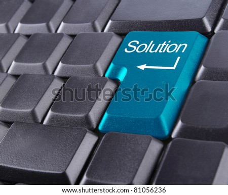 keyboard with blue solution button - stock photo