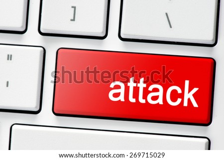 Keyboard with button attack. Computer white keyboard with red button attack - stock photo