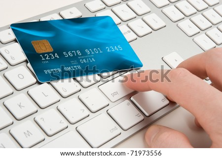 Keyboard with button pay and credit card - payment concept I am author of image used on credit card and used data are fictitious. - stock photo