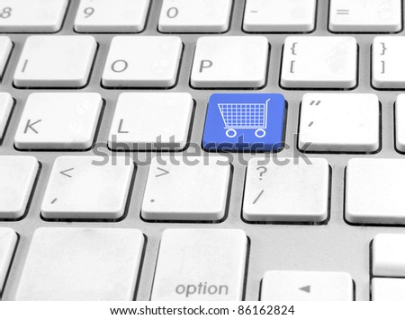 Keyboard with button Shopping cart - stock photo