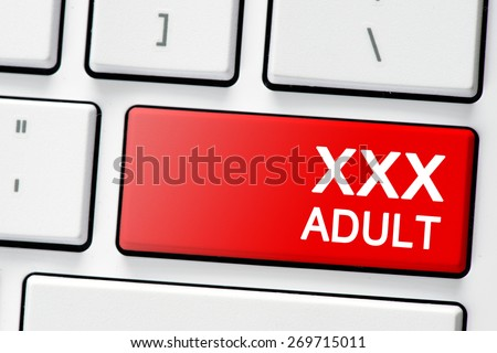Keyboard with button xxx adult. Computer white keyboard with red button xxx adult - stock photo
