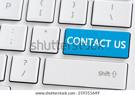 Keyboard with contact us button. Computer keyboard with contact us button - stock photo