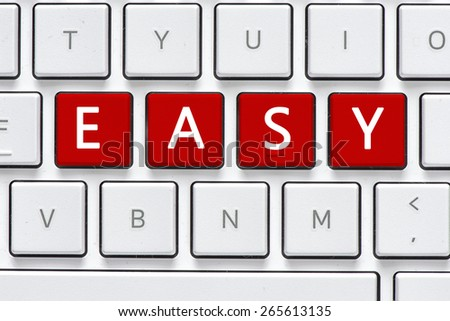 Keyboard with easy buton. Computer white keyboard with easy button - stock photo