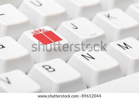 Keyboard with gift symbol key - online christmas present shopping concept - stock photo