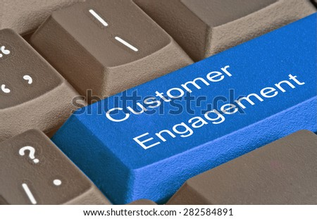 Keyboard with key for customer engagement - stock photo