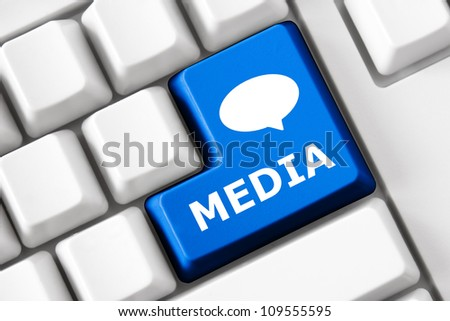 Keyboard with Media text and bubble symbol - stock photo