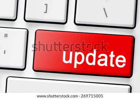 Keyboard with red button update. Computer white keyboard with red button update - stock photo