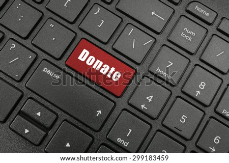 Keyboard with red donate button - stock photo