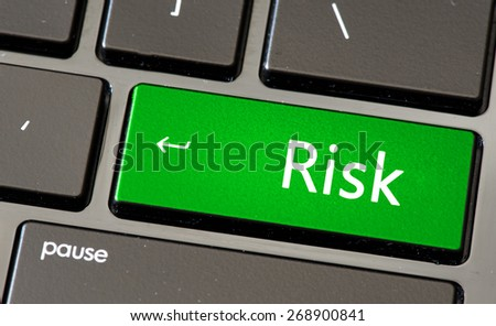 Keyboard with risk button - stock photo