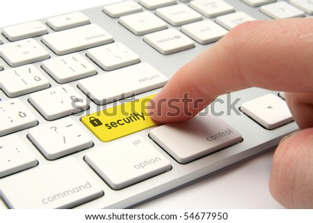 Keyboard with security button - computer security concept - stock photo