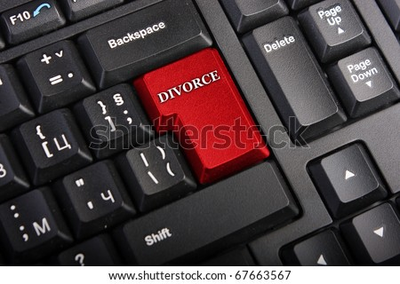 Keyboard with selective focus on the enter button saying DIVORCE - stock photo