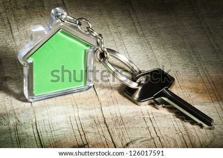Keychain figure of house and key close up - stock photo