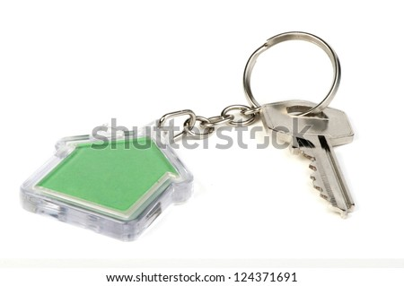 Keychain with figure of green house - stock photo