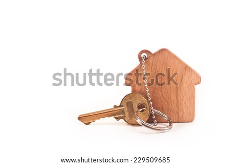 Keychain with the silhouette of the house and key on white background - stock photo