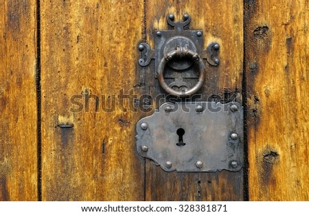 Keyhole and door pull of Stave Church in Lom, Norway - stock photo
