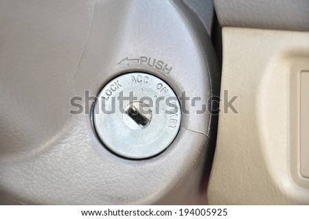 Keyhole for starting the car - stock photo