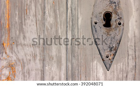 Keyhole in an Old Wooden Door