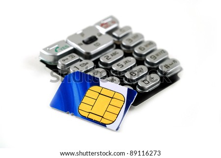 keypad and sim card found on cell phones - stock photo