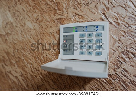 Keypad for access control at home security - stock photo