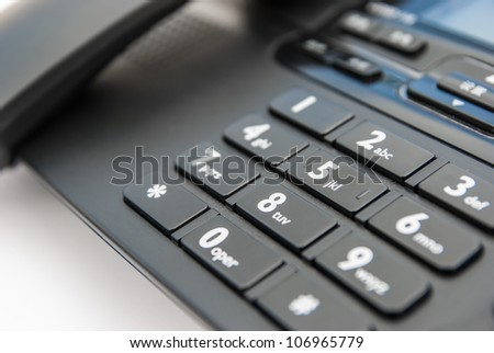 keypad of a black telephone - stock photo