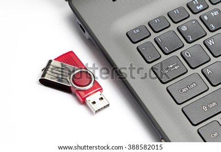 Keypad of a notebook and usb drive. Fragment of the keypad of the modern notebook and usb flash drive. - stock photo