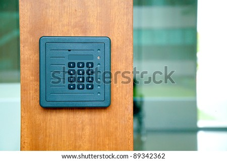 keypad on security door - stock photo