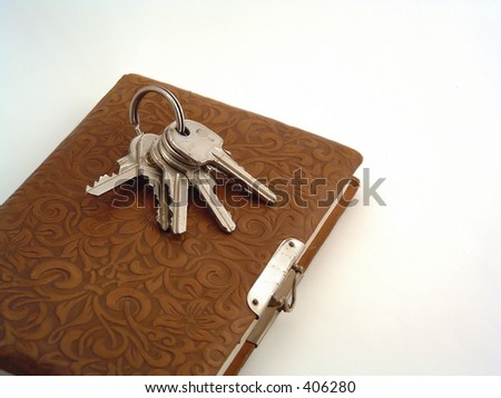 keys and an retro diary - stock photo
