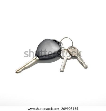 keys and car key isolated on white background - stock photo