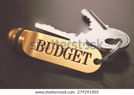 Keys and Golden Keyring with the Word Budget over Black Wooden Table with Blur Effect. Toned Image. - stock photo