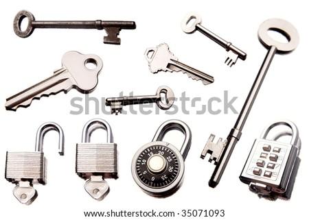 Keys and padlocks isolated over white background - stock photo