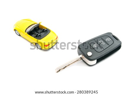 keys and yellow sport car closeup on white