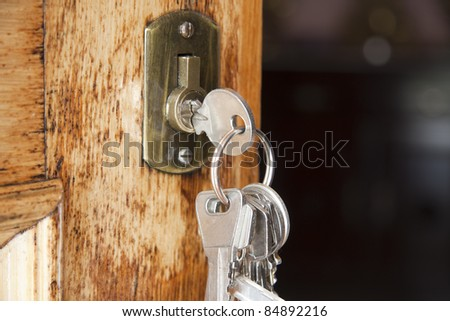 keys at the front door of the house - stock photo