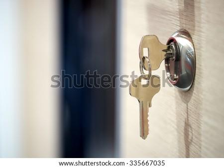 keys in the keyhole - stock photo
