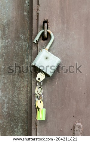 Keys in the lock hanging on the door handle - stock photo