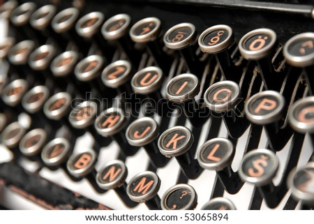 Keys of an old rusty typewriter - stock photo