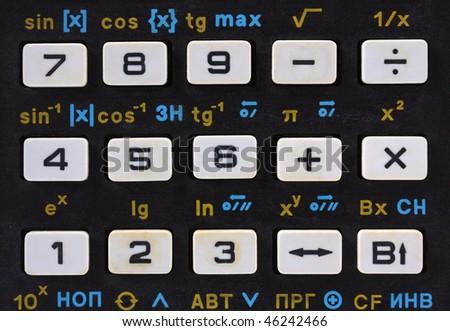 Keys of old scientific calculator - closeup view. - stock photo