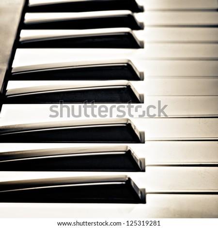 keys of piano, black and white, closeup - stock photo