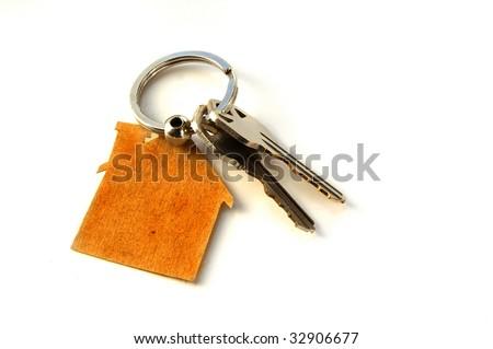 Keys on a house key-chain (New House keys) - stock photo
