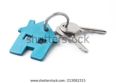 keys on a keyring with a house isolated on white.