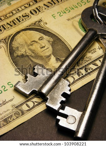Keys on a one dollar banknote - stock photo