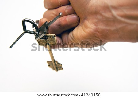 Keys on finger - stock photo