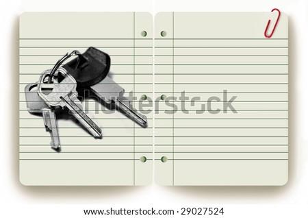 Keys on notepad - stock photo